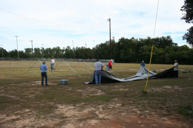 Putting up the tent for the Pine Forest United Methodist Church Arts & Crafts Festival &Car Show